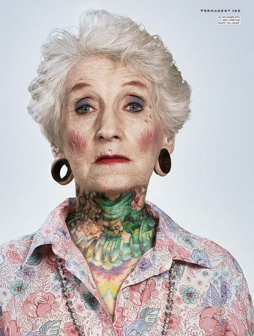 Grandmother with colorful tattoo on neck