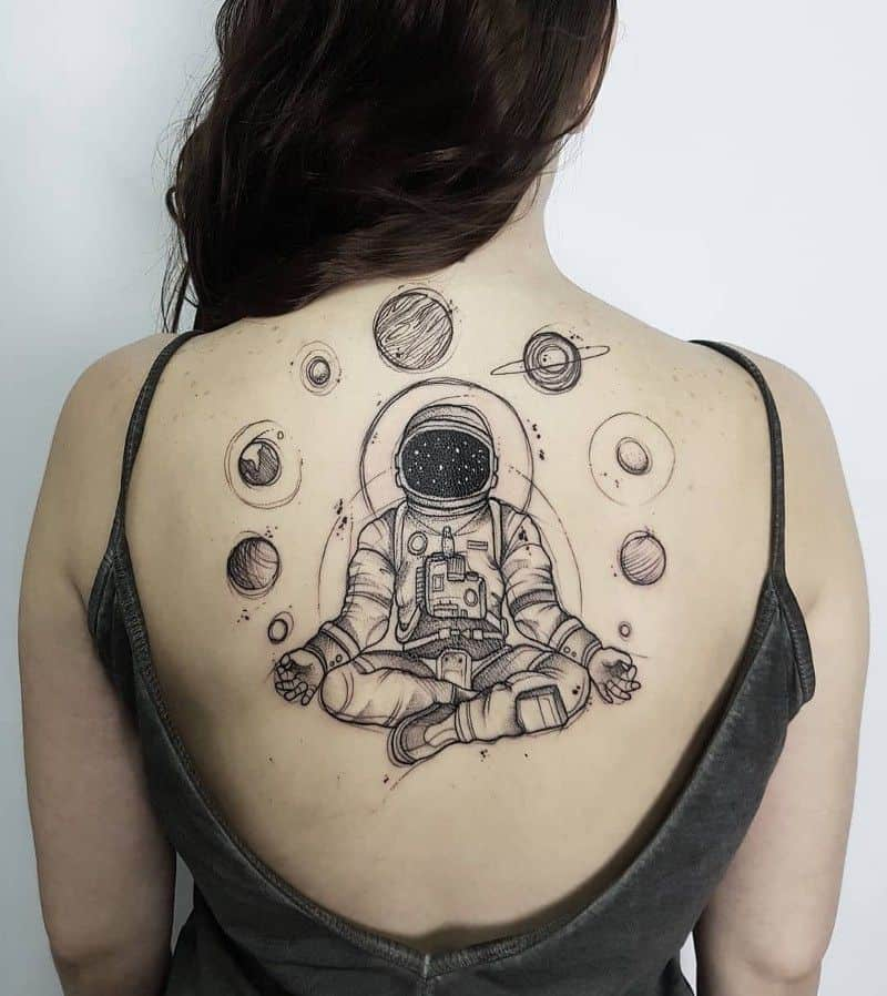 Cosmonaut and planets tattoo on back