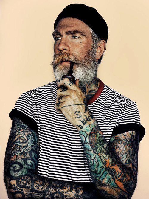 Old man tattoo on arm