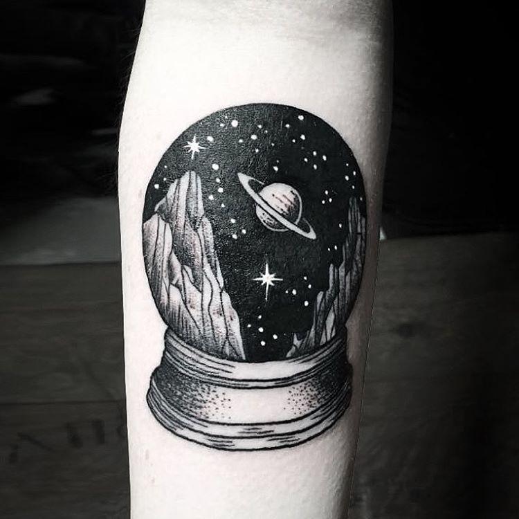 Saturn tattoo on arm