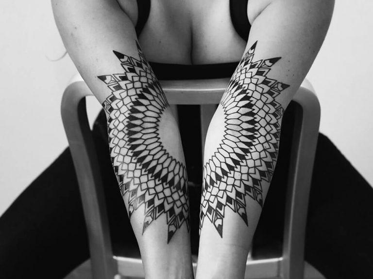 Matching forearm tattoos