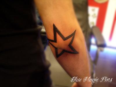 Star tattoo on elbow ideas