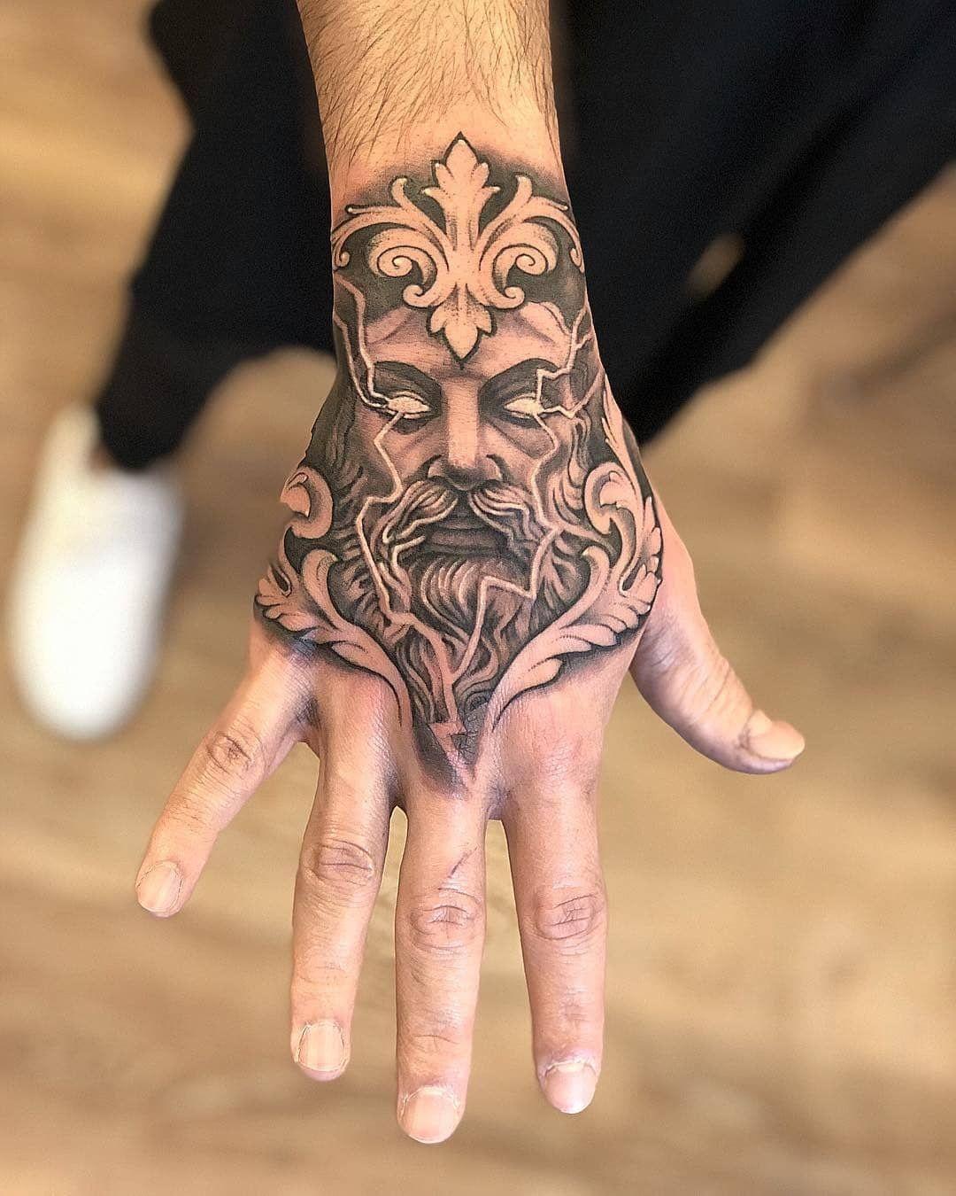 Zeus tattoo on hand