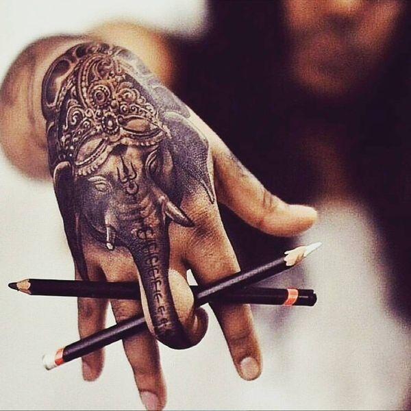Magical elephant tattoo on the hand