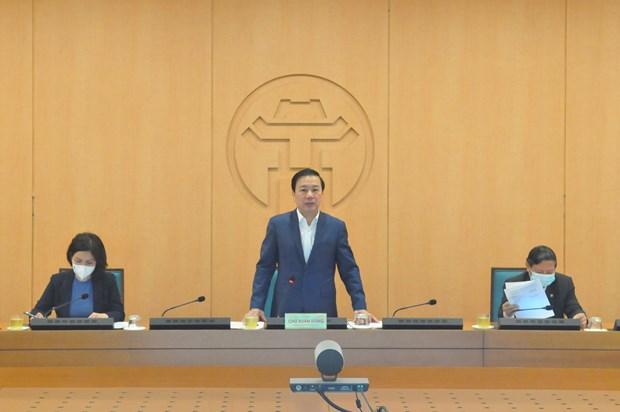 Le vice-président du Comité populaire de Hanoï, Chu Xuan Dung, a présidé   une réunion du Comité de pilotage pour la prévention et le contrôle de   l'épidémie de COVID-19. Photo: Vietnam+