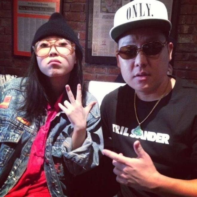 Awkwafina stands in full blaccent persona with Eddie Huang.