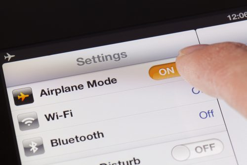 Why You Should Switch Your Phone To Airplane Mode On A Flight