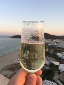 Glass of cava rooftop in Ibiza, Spain.