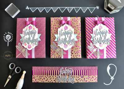 Boîtes cadeaux anniversaire Thinlits Happy Birthday et son tutoriel Framelits Plein d'étiquettes, Papier Design Spécialité Frénésie métallisée, perforatrice Etiquette en fanion, Perforatrice Nœud, Set de tampons Joyeux anniversaire beauté, Thinlits Happy Birthday, Thinlits Libellule ouvragée par Marie Meyer Stampin up - http://ateliers-scrapbooking.fr/ - Birthday box Thinlits Happy Birthday tutorial, Labels Framelits Dies, Foil Frenzy Specialty Designer Series Paper, Banner Triple Punch, Bow Builder Punch, Happy Birthday Gorgeous Stamp, Detailed Dragonfly Thinlits Dies, Envelope Punch Board -Geburtstag geschenk Thinlits Happy Birthday anteilung, Framelits Etikett-Kollektion, Besonderes Designerpapier Metallic-Glanz, Fähnchen, dreifach einstellbars Stanze, Schleife, Elementstanze, Alles Liebe, Geburtstagskind Stempel, Thinlits Libelle, Stanz- und Falzbrett für Umschläge