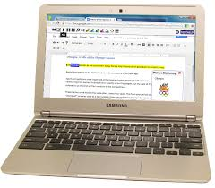 A laptop, with a Google Chrome App open on the laptop.