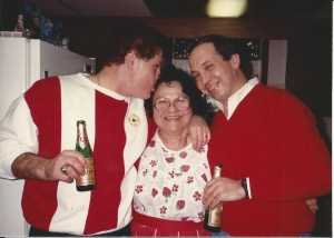 An adoring mother with Kings #1 and #2. (It's Christmas Eve in this shot too -- hence the beers.)