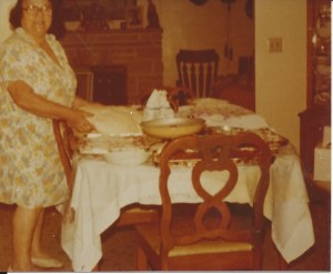 Mom making bread.  If you look closely, you can see three cookie sheet sized  pizzas on the table.