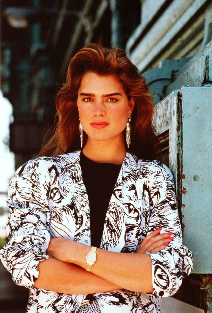 23 awesome  80s hairstyles that are making a comeback 80s hairstyles  Young Brooke Shields with brown big blow dried  80s hair  wearing a