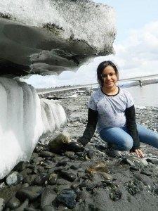 Ermelina by a huge ice chunk along the Susitna River by Angela Gonzalez