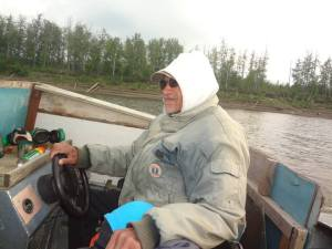 Al Yatlin Sr. driving his boat along the Koyukuk River. Photo by Tanya Yatlin