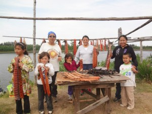 Cutting fish at fish camp along the Koyukuk River. L-R: Lydia, Gage, Eleanor, Chloe, Agnes, Vanessa and Jubilee. Photo by Tanya Yatlin