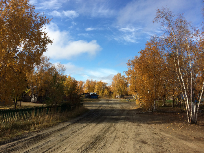 Many roads in rural Alaska are sand or gravel, like this one in Huslia. Photo by Angela Gonzalez