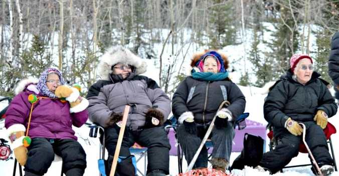 Some of the biggest fans of the races on the Koyukuk River races. Photo by Dolly Simon-Dayton