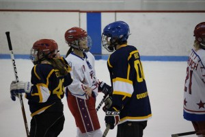 Amber Steinhilpert (in red & white) after a hockey game. Photo by Angela Gonzalez