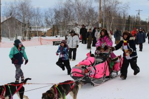 2017 Iditarod Musher Dee Dee Jonrowe arrives in Huslia. Photo by Angela Gonzalez