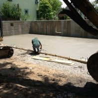 pouring-concrete-floor-of-garage