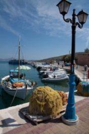 Fishing_boat_and_nets_at_Megalochori,_Agkistri_Island,_Greece