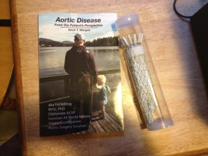 FitOldDog's first paperback, Aortic Disease From The Patient's Perspective,' and the stent graft that permitted it.