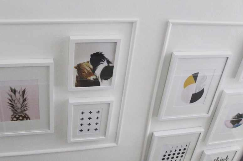 How to create a modern stair gallery wall. Ideas on layout, artwork, and how to hang pictures. Perfect for stairways in a small home.