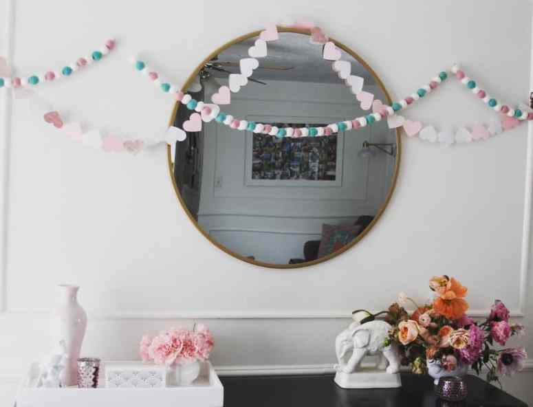 Cute and easy DIY Valentine's decor! This felt ball garland and fringe crepe paper garland are super fun for home holiday decorating.