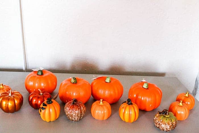 dollar store pumpkin makeover. This colorful diy is a super fun and easy project that would be a great craft with kids! These fun pumpkins are painted with chalk paint and are perfect for halloween decorations. Click through for a project tutorial.