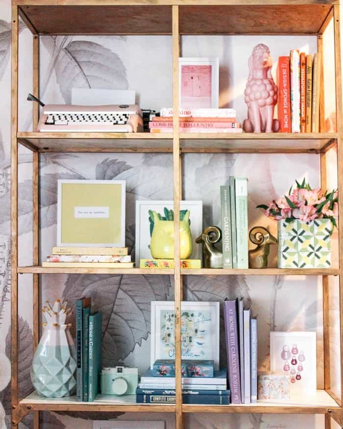 One Room Challenge Week 3. Rainbow bookcase with colorful accessories and art. DIY gold shelves IKEA hack
