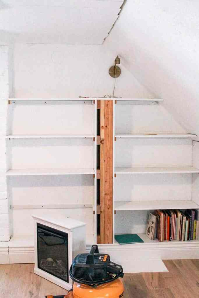 DIY built in bookcase. An easy and cheap book shelf that goes wall to wall and incorporates a fireplace and window seat. I'll show how we built it for $250. Plus styling ideas and a cheat sheet of which decor to use and organization to create this rainbow bookcase