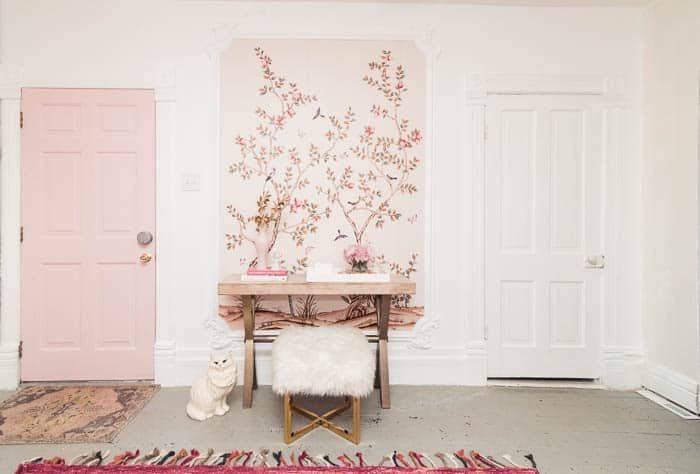 DIY framed wallpaper mural with molding. I just framed Chinoiserie wallpaper in our living room/ entry and it is such a statement! I'm sharing ideas and products for how to make this large wall art look in your house. Click through for the video tutorial and lots of tips to get it right!