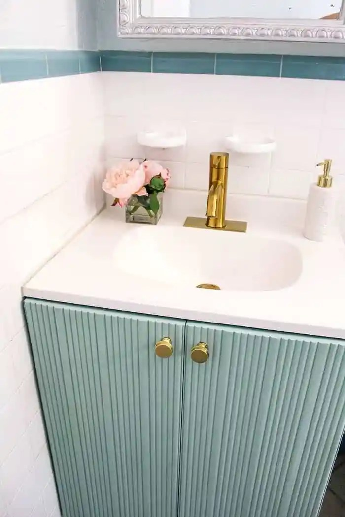 How Do You Change a 3 Hole Faucet to 1 hole? I fell in love with a modern gold bathroom faucet. But my vanity had 3 holes. How I solved that design issue and got the brass faucet of my dreams