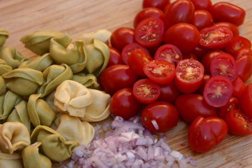 Buy the freshest tortellini available and the sweetest organic pearl or cherry tomatoes, and the most tender baby spinach.