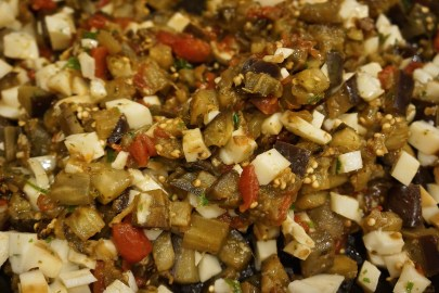 Cool the eggplant mixture slightly. Mix in chunks of mozzarella and set aside.