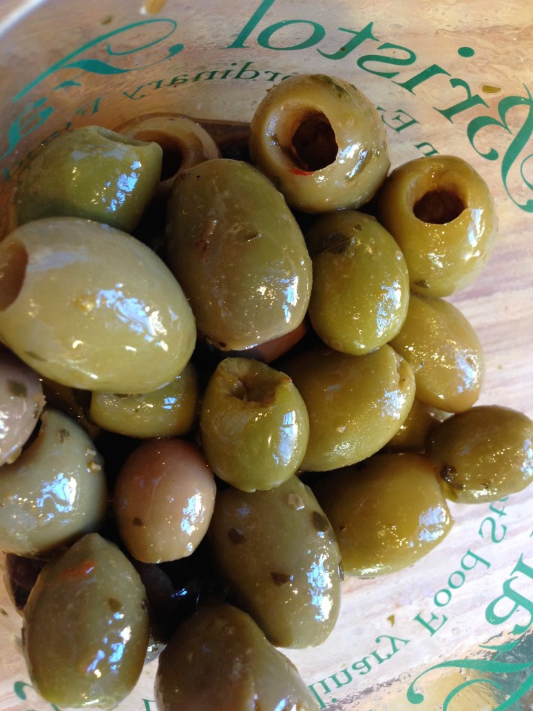 Add some really good imported olives, green or black.