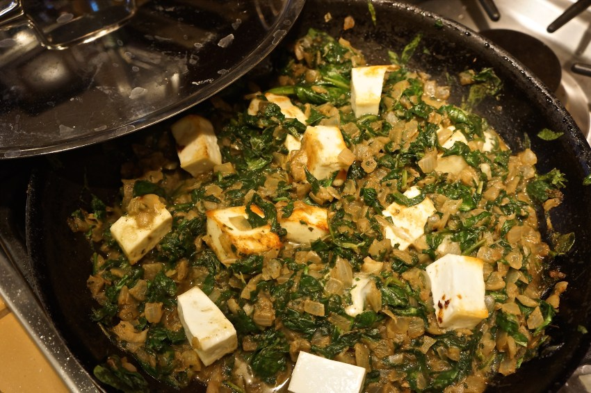 Stir the paneer into the spinach mixture. Gently mix.