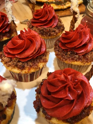 #6 Vanilla cupcake with sugar bacon, bacon jam, and tomato buttercream frosting