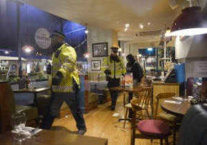 Police officers inside a branch of Bella Italia in Leicester Square, London, after a man took a woman hostage with a knife in the restaurant. PRESS ASSOCIATION Photo. Picture date: Wednesday February 24, 2016. See PA story POLICE Restaurant. Photo credit should read: Hannah  McKAY/PA Wire