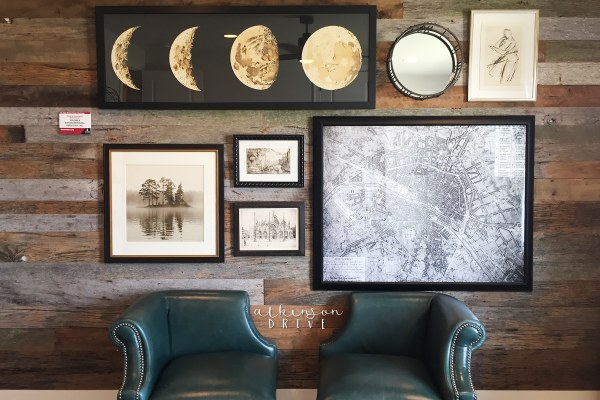 Home office feature wall with distressed barn wood and a beautiful gallery of photos