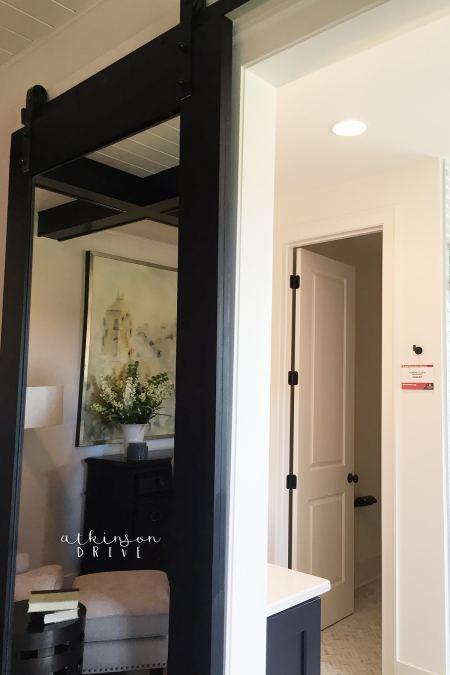 Save space in your master bedroom with a mirrored barn door