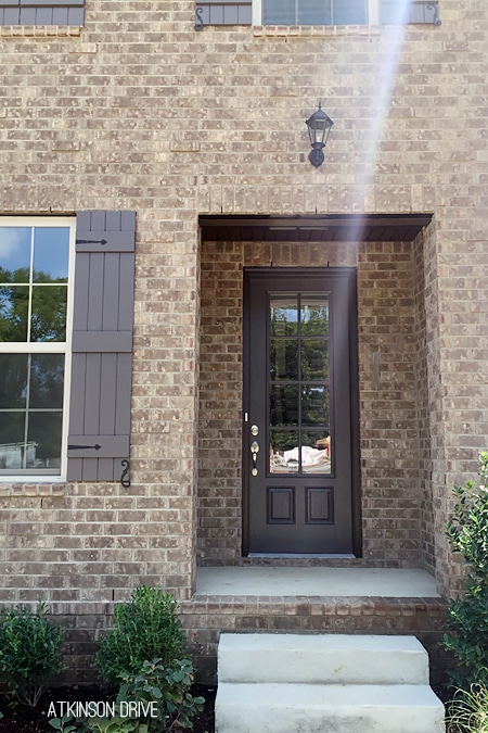 New Home: Brick exterior with an 8 foot front door and painted wood shutters.