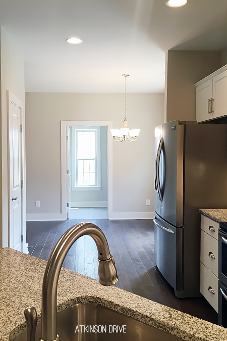 New Home: An open concept kitchen-dining space which flows into the laundry room