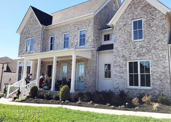 Beautiful traditional home with whitewashed brick exterior and light blue french doors /// Woodridge Parade of Homes Tour by Atkinson Drive