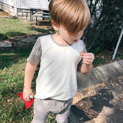 We all know kids need sturdy adventuring clothes - which is where our edgy tee comes in! With a loose fit and raw hems, it's comfy yet stylish!