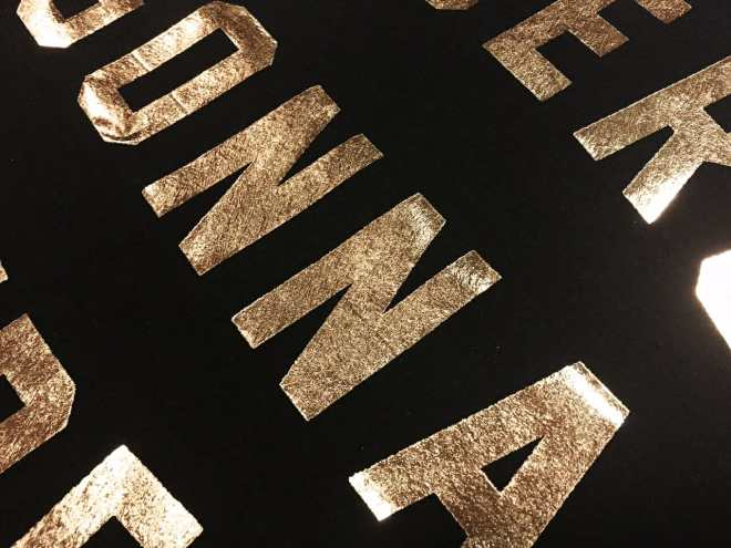 Gold Foil on a Black T-shirt - Marshall Atkinson