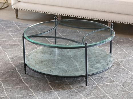 round metal coffee table with mirrored bottom