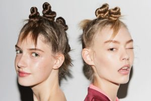 As the weather warms, we've got to think of creative ways to get our hair up and off our faces while still looking cool and chic! That's why the twisted mini buns inspired by Guido Palau's from the Marc by Marc Jacobs SS15 show proves to be the perfect spring/summer hairstyle. Pair it with bold lipstick for a night out, tribal inspired makeup for a summer festival, or with dewy makeup for a rooftop BBQ. Source: ManeAddict.com