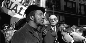 At a rally outside the U.S. Courthouse October 29, 1969, Dr. Benjamin Spock, background, listens to Fred Hampton, chairman of the Illinois Black Panther party. It was part of a protest against the trial of eight persons accused of conspiracy to cause a riot during the Democratic National Convention in 1968. (AP Photo/stf)